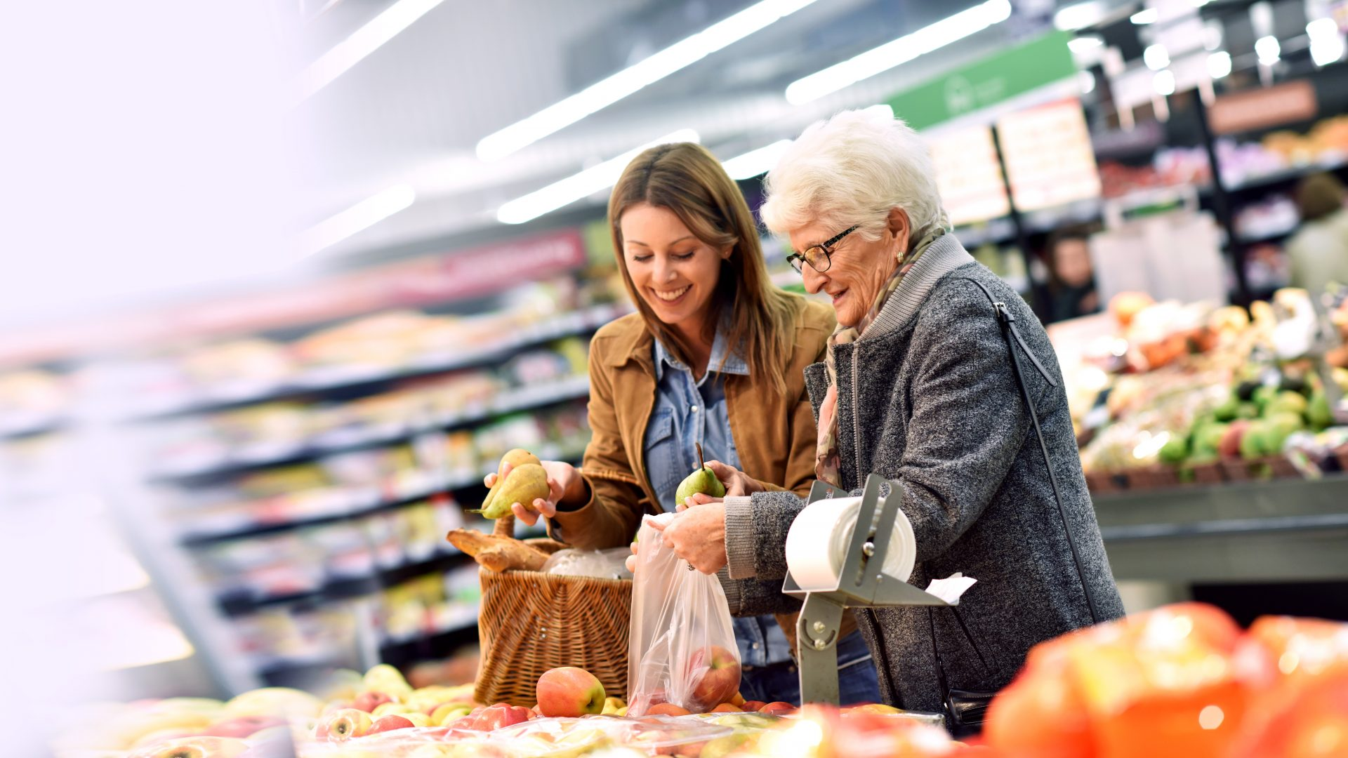 carer with elderly lady shopping